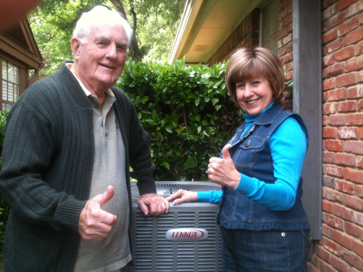 Aire Serv sweepstakes recipient Joanne Collmar, right, stands next to the Lennox air conditioning unit that was installed by Aire Serv of Fort Worth.