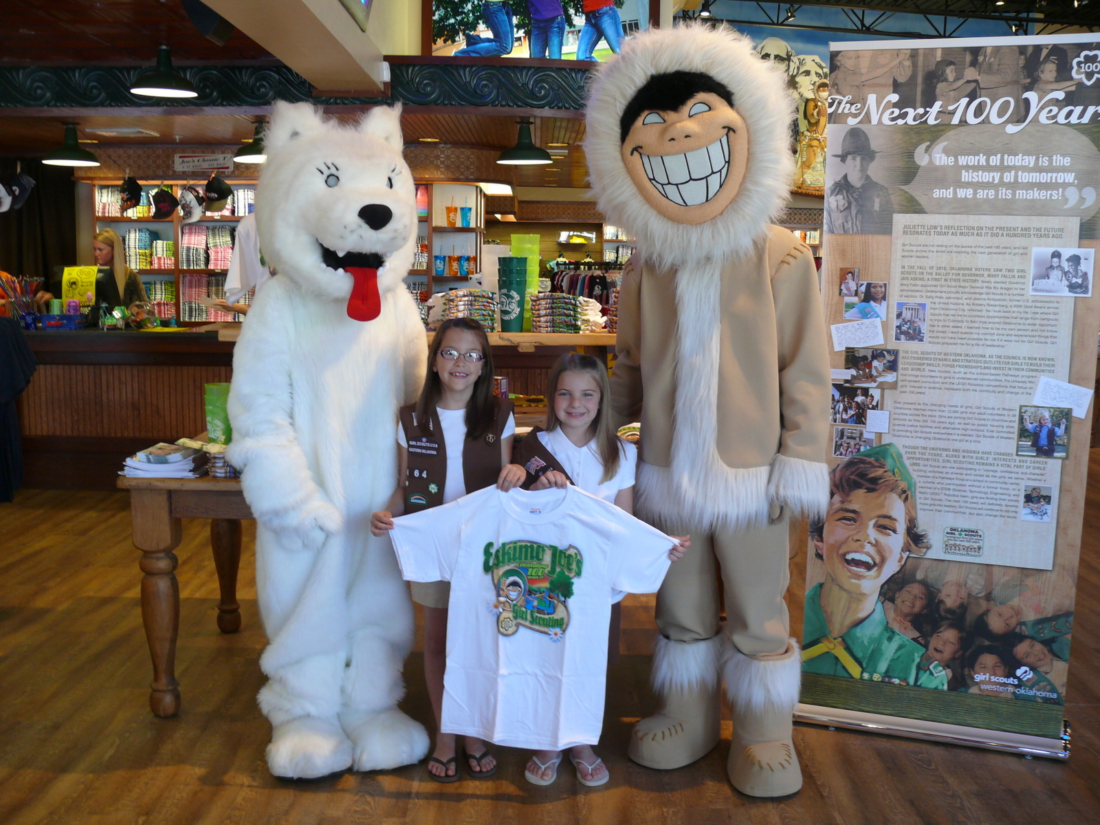 Eskimo Joe&#39;s unveils Girl Scouts&#39; 100th anniversary t-shirt with Stillwater Girl Scouts Lydia and Kirstyn and friends Buffy and Eskimo Joe.