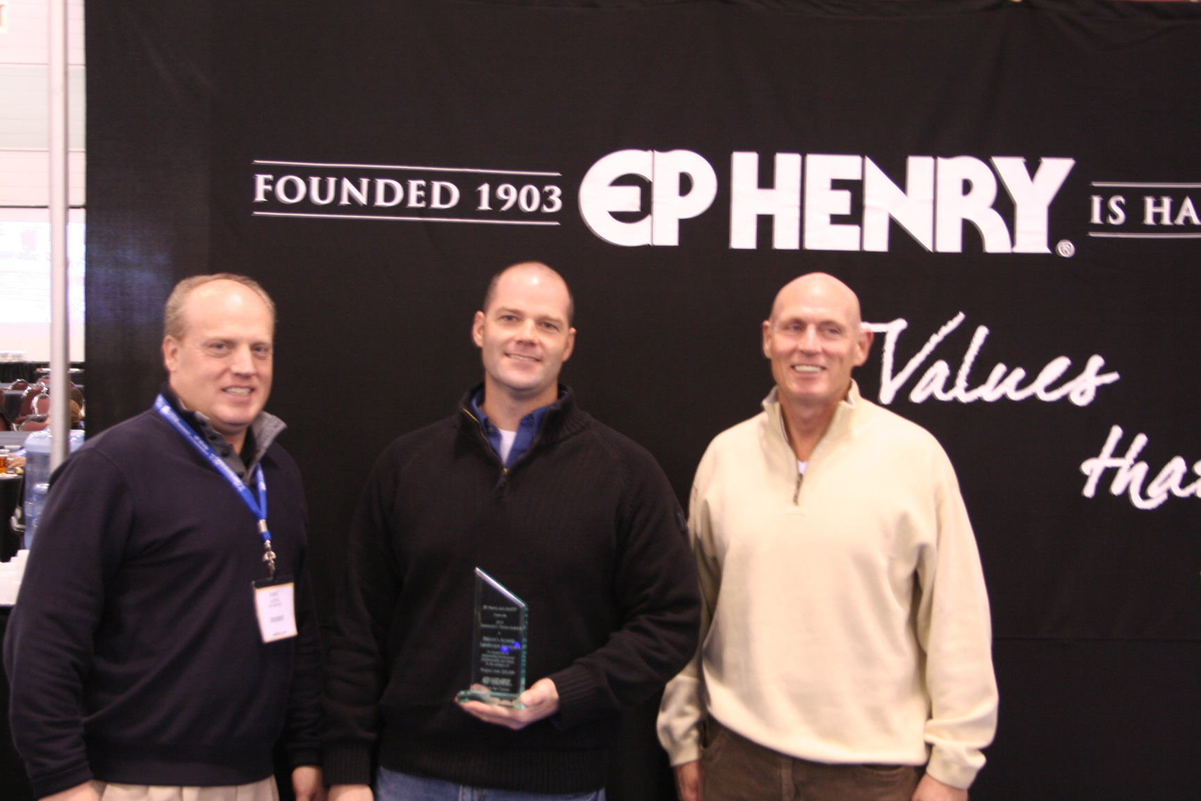 Winner Travis Breininger of Nature's Accents with EP Henry representatives