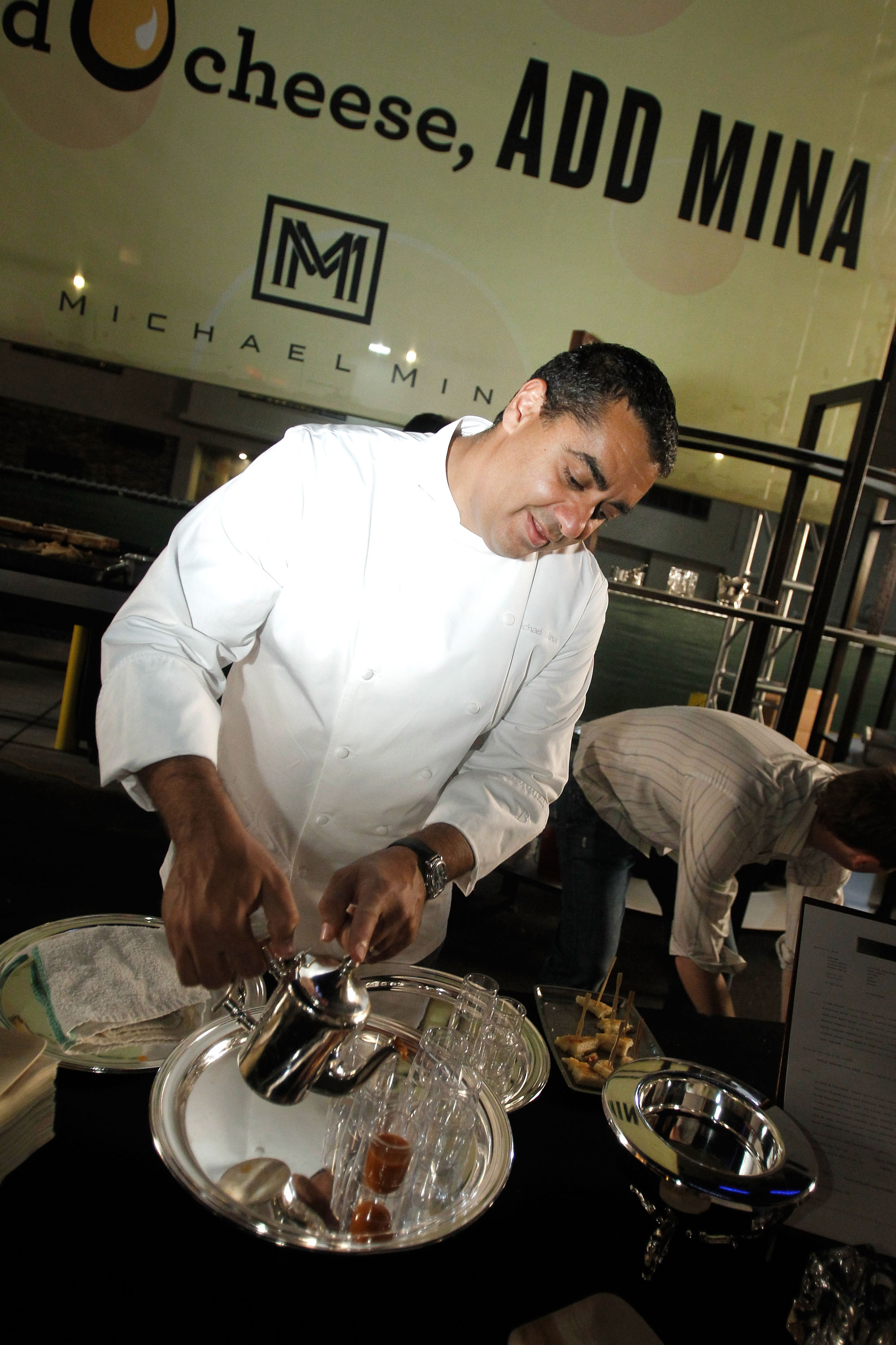 Michael Mina serving guests at Follow That Food Truck at Bellagio for Vegas Uncork&#39;d (photo credit: Isaac Brekken)