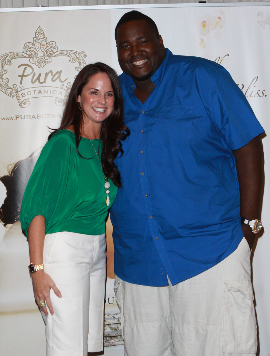Pura Botanica owner Christy Booth with The Blind Side star Quinton Aaron.
