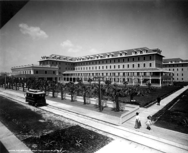 A horse-drawn railway car passes the Breakers hotel, Palm Beach
