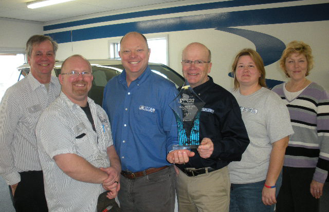 M.C. Mobility Systems Dayton team with their customer satisfaction award