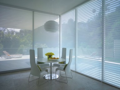 To create a light summer space with enhanced protection from the sun's harmful UV rays, try Hunter Douglas Silhouetter window shadings.