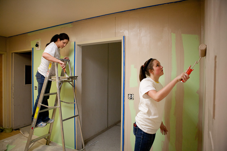 Teammates working hard painting