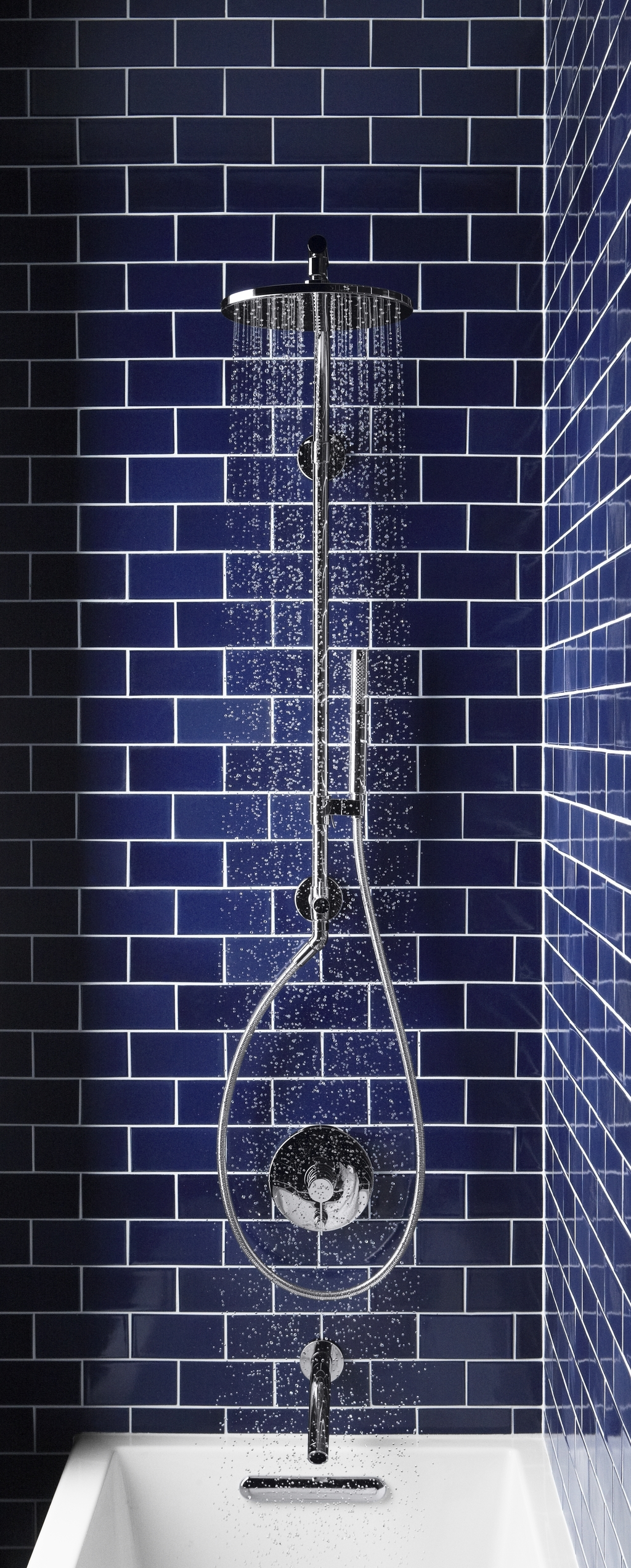Easy to install kohler hydrorail shower column transforms for Dark blue bathroom tiles