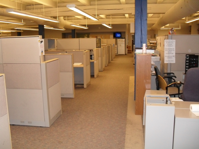 The old workstations at DaVita's Tacoma business office before the environmentally friendly renovations.
