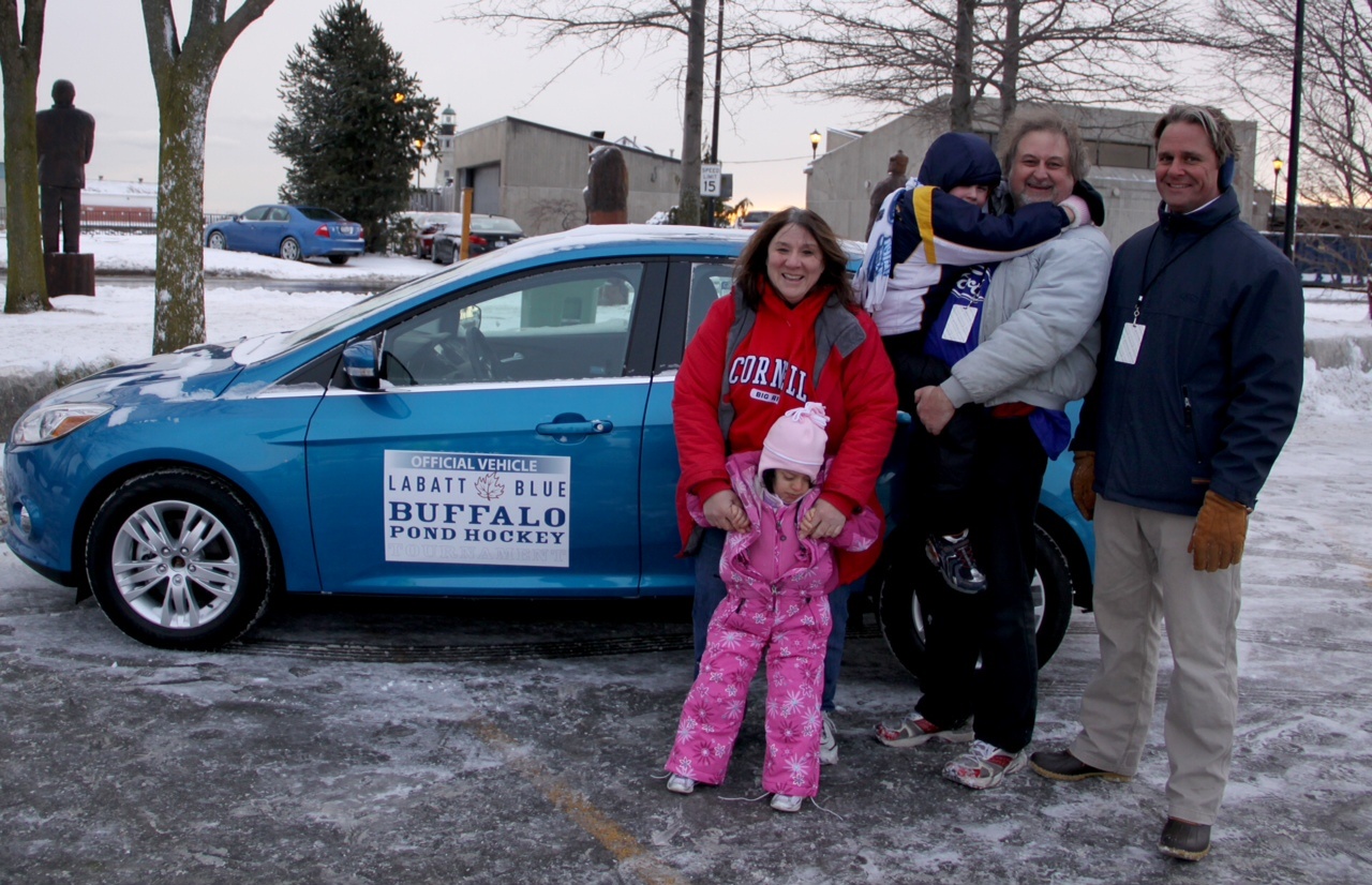 The Dale family poses with their new car - a 2012 Ford Focus - and Dave Smith of the WNY Ford Dealers, after winning the Ford Hockey Shootout in Buffalo.