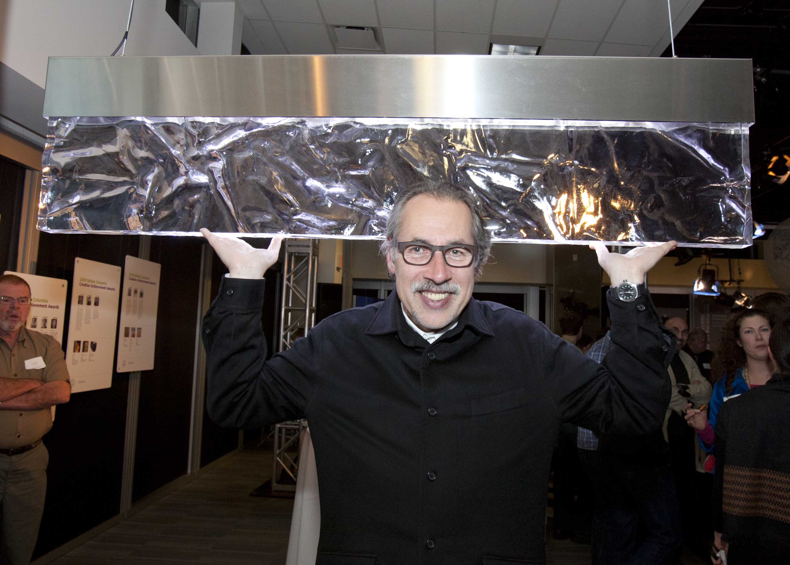 Joel Berman, shown here with his award-winning Heat light sculpture, received the Carter Wosk British Columbia Creative Achievement Award for Applied Art & Design