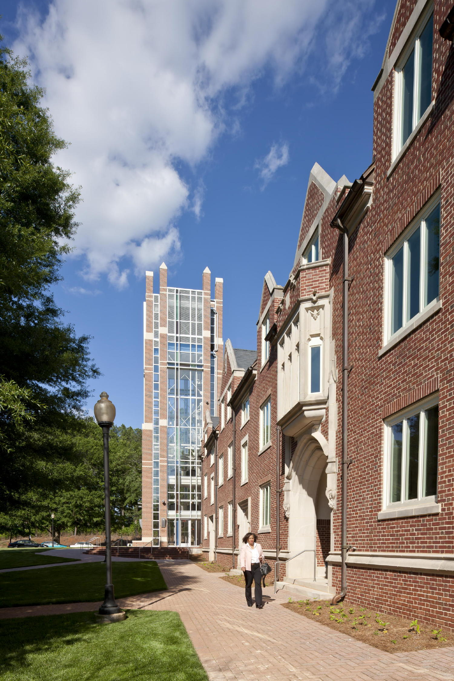 Lord, Aeck & Sargent's assessment of Columbia Theological Seminary's master plan led to the conclusion that the three-story historic dormitory (right), built in 1932, was of significant historical value, so the architects rehabilitated the building and inserted the smaller program spaces inside. Larger classroom areas and campus receiving functions are in the added wings. The 80-foot-tall tower (background) knits together existing and new construction. c 2012 Jonathan Hillyer / Atlanta