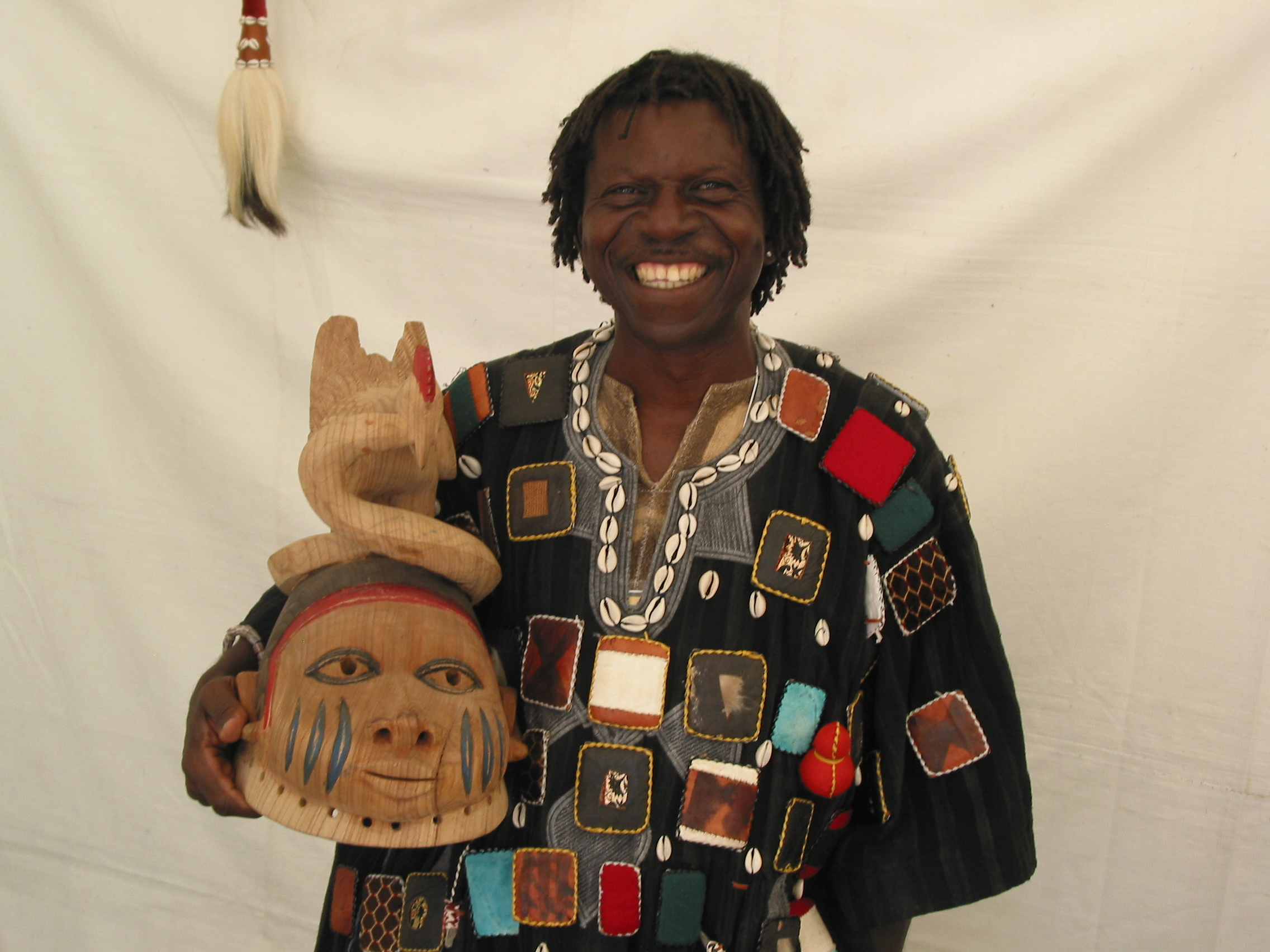 Djam Vivie was named a master wood carver by his community in Ghana before moving to Madison.  Shown here with a mask he made.