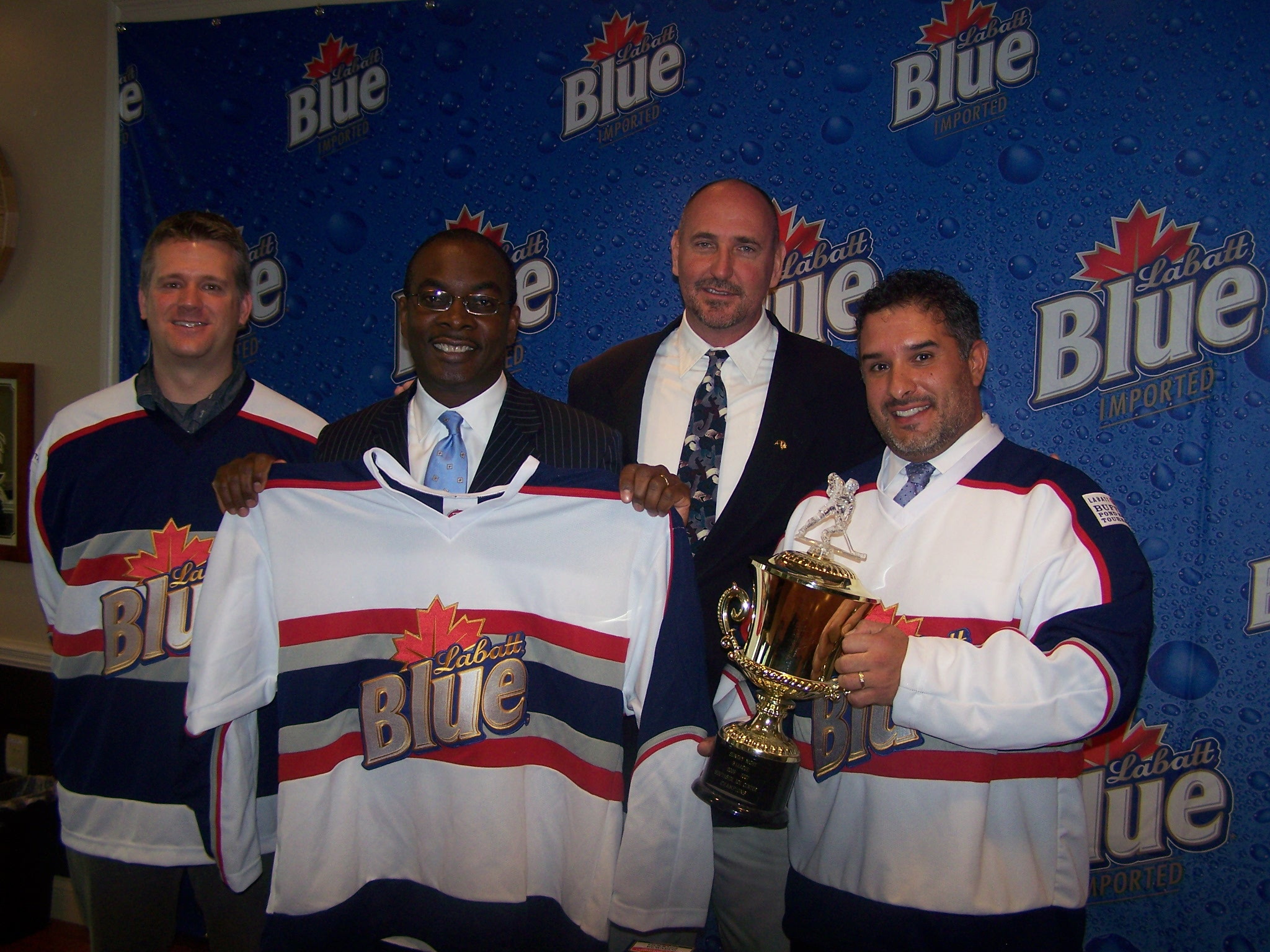 From Left to Right: Brett Carlsen, associate brand manager, Labatt Blue; The Hon. Mayor Byron Brown, City of Buffalo; Commissioner Steve Stepniak, City of Buffalo, and Don Poleto, operations engineer, City of Buffalo Public Works