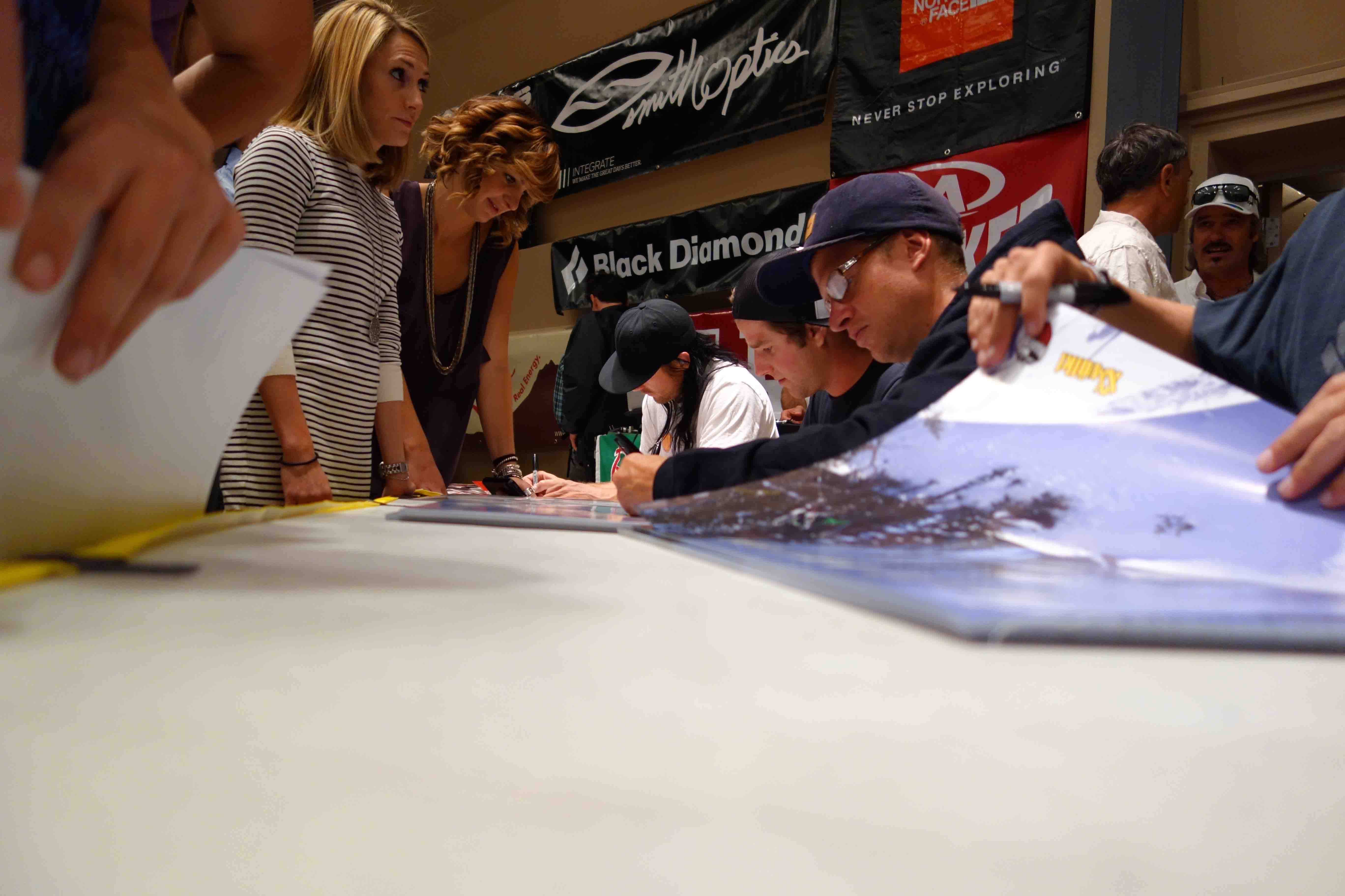 Seth Morrison, Dash Longe & Dylan Hood sign posters. Photo: Greg Fitzsimmons