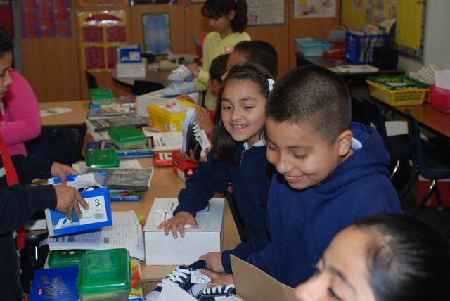 Excited students from Lincoln Elementary in Santa Ana compare their new shoes, donated by DaVita teammates and Shoes that Fit volunteers.