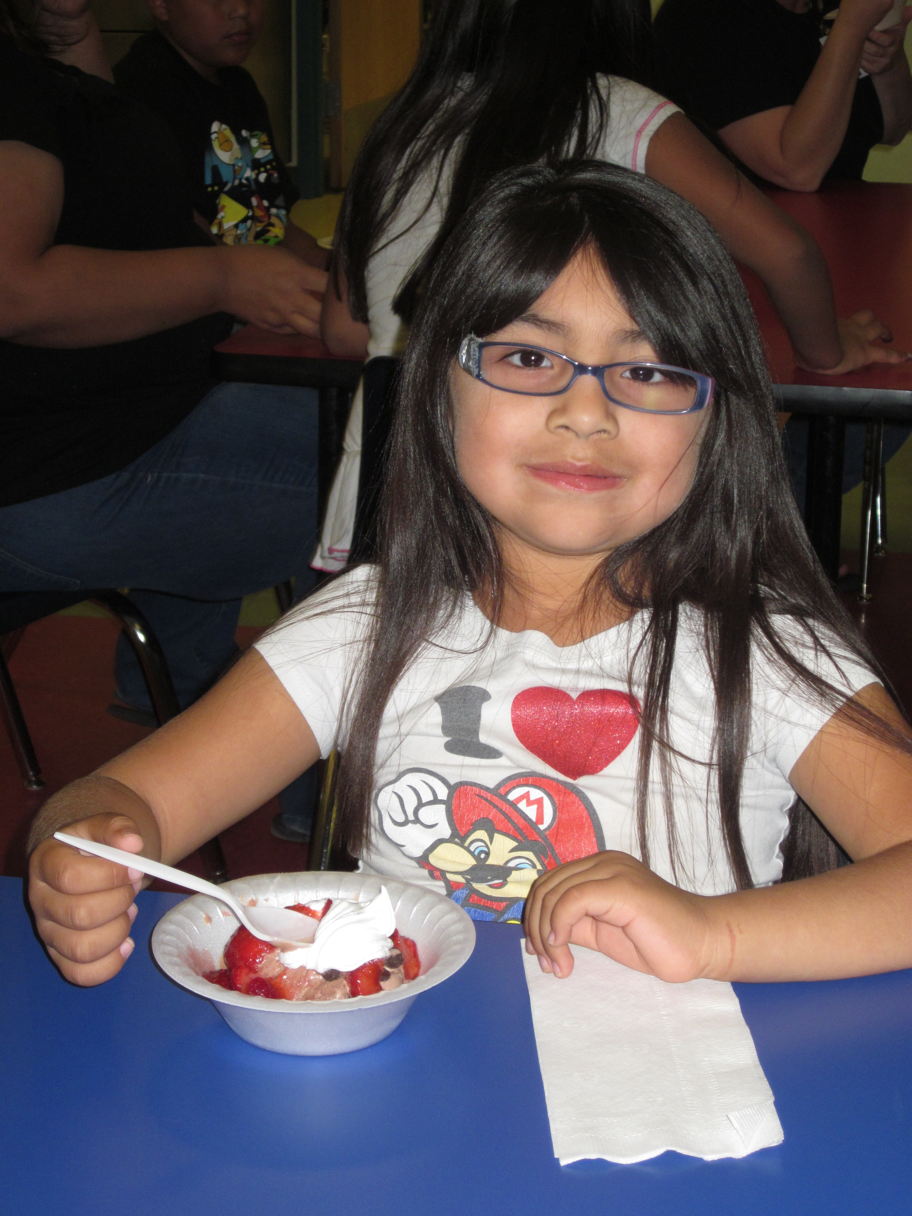 Araya Pena enjoys her personalized Ice Cream Sundae, at the Ak-Chin Child Development's Ice Cream social, which was held to Celebrate The Week of the Young Child.