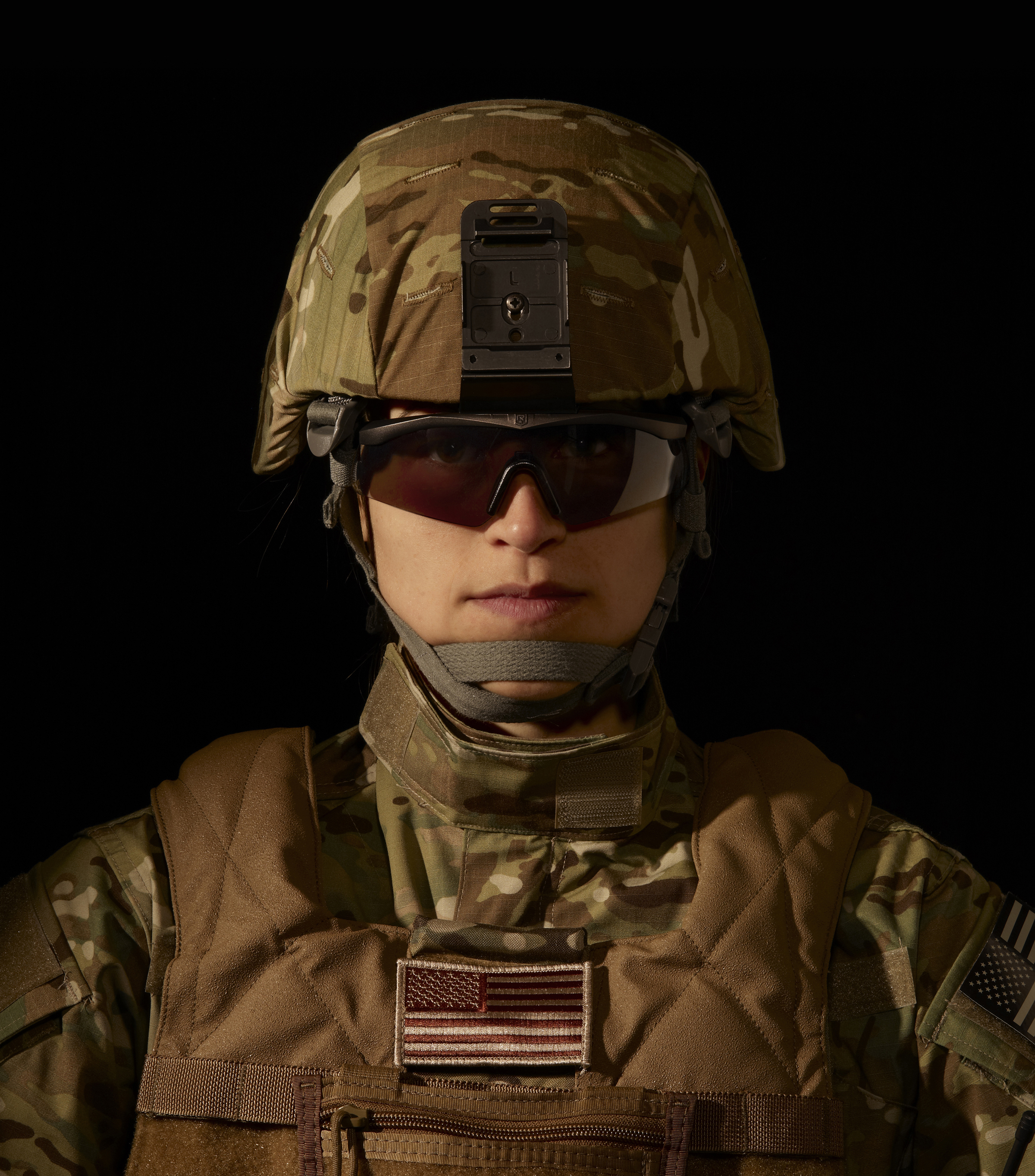 A female soldier wears the Sawfly Military Eyewear System in size Small. It has been specifically developed to follow the contours of smaller face proportions.