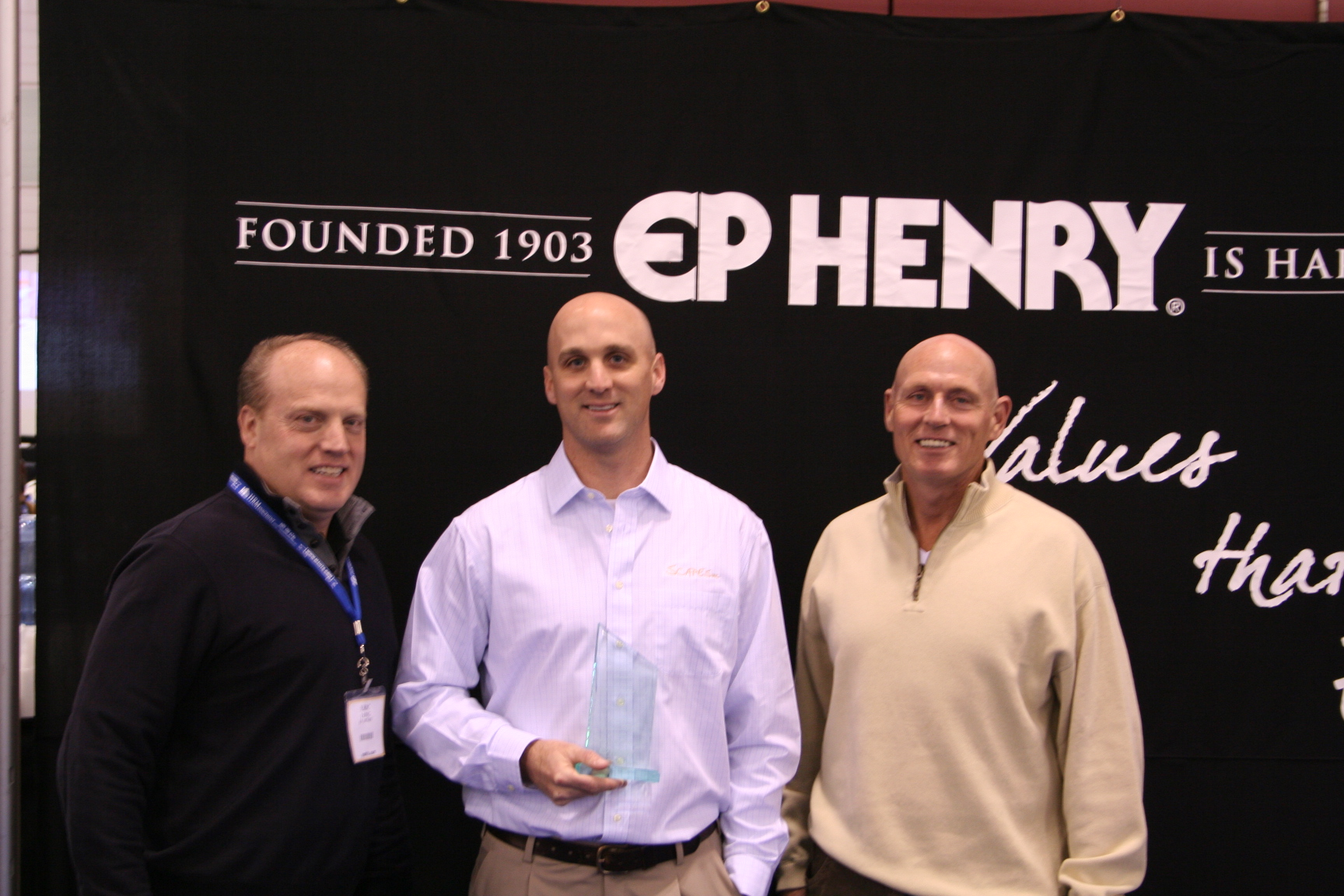Winner Jeff Crandell from Scapes, Inc. accepts his award with representatives from EP Henry.