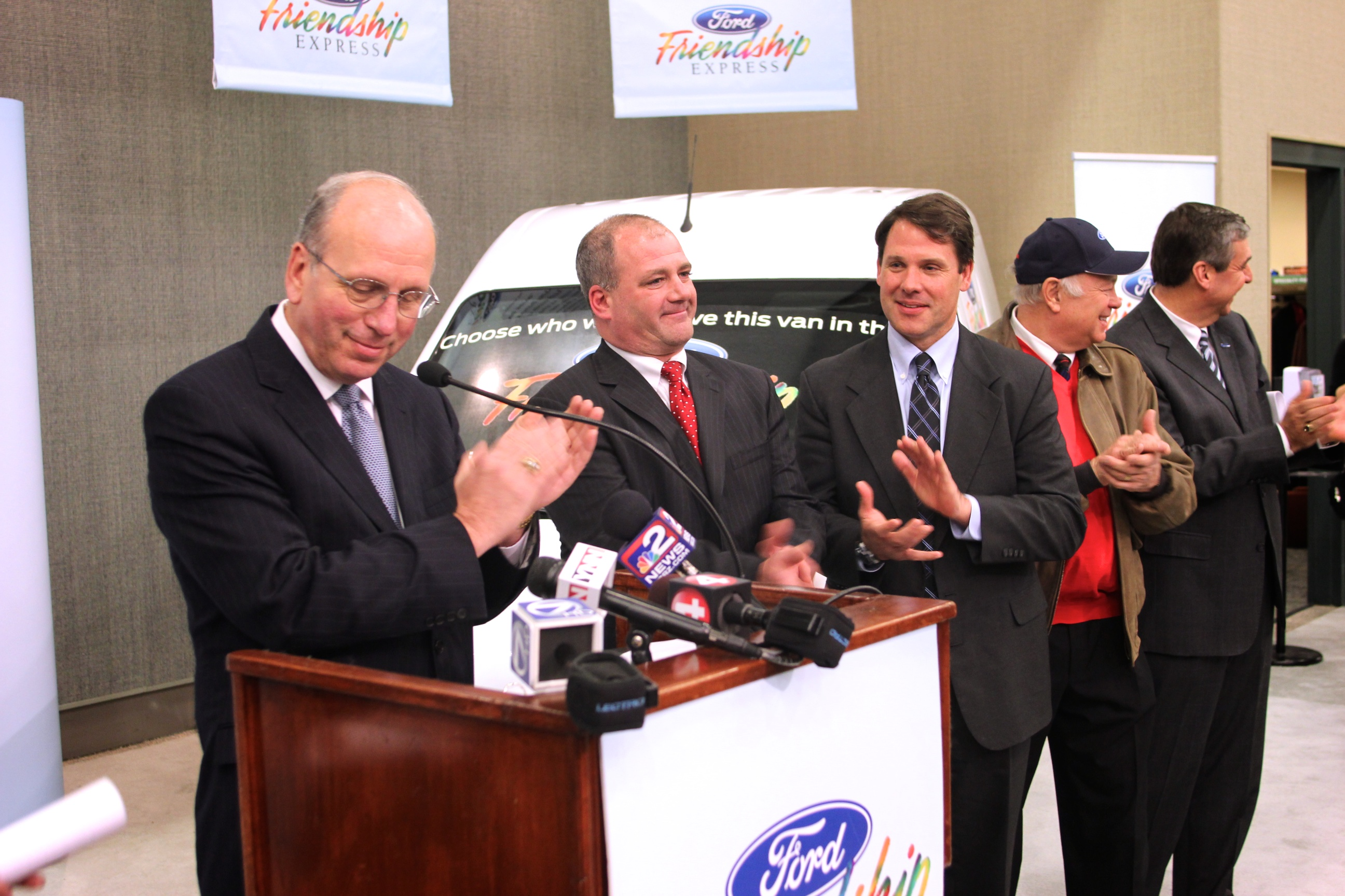 WNY Ford Dealers announce 2012 Ford Friendship Express van recipients at Buffalo Auto Show. (From left: Scott Bieler, chairman of Ford Friendship Express Selection Committee; Selection Committee: Peter Delacy, Frank Downing, and Carl Emerling; John Schuldt, Regional Manager for Ford Motor Company.