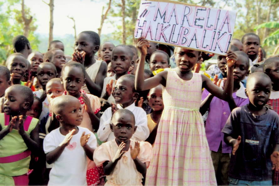 "These African children hold a sign that says, ""Malaria is Unacceptable."""