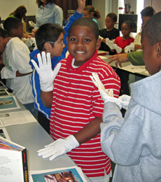 Photo of students working with historic documents.