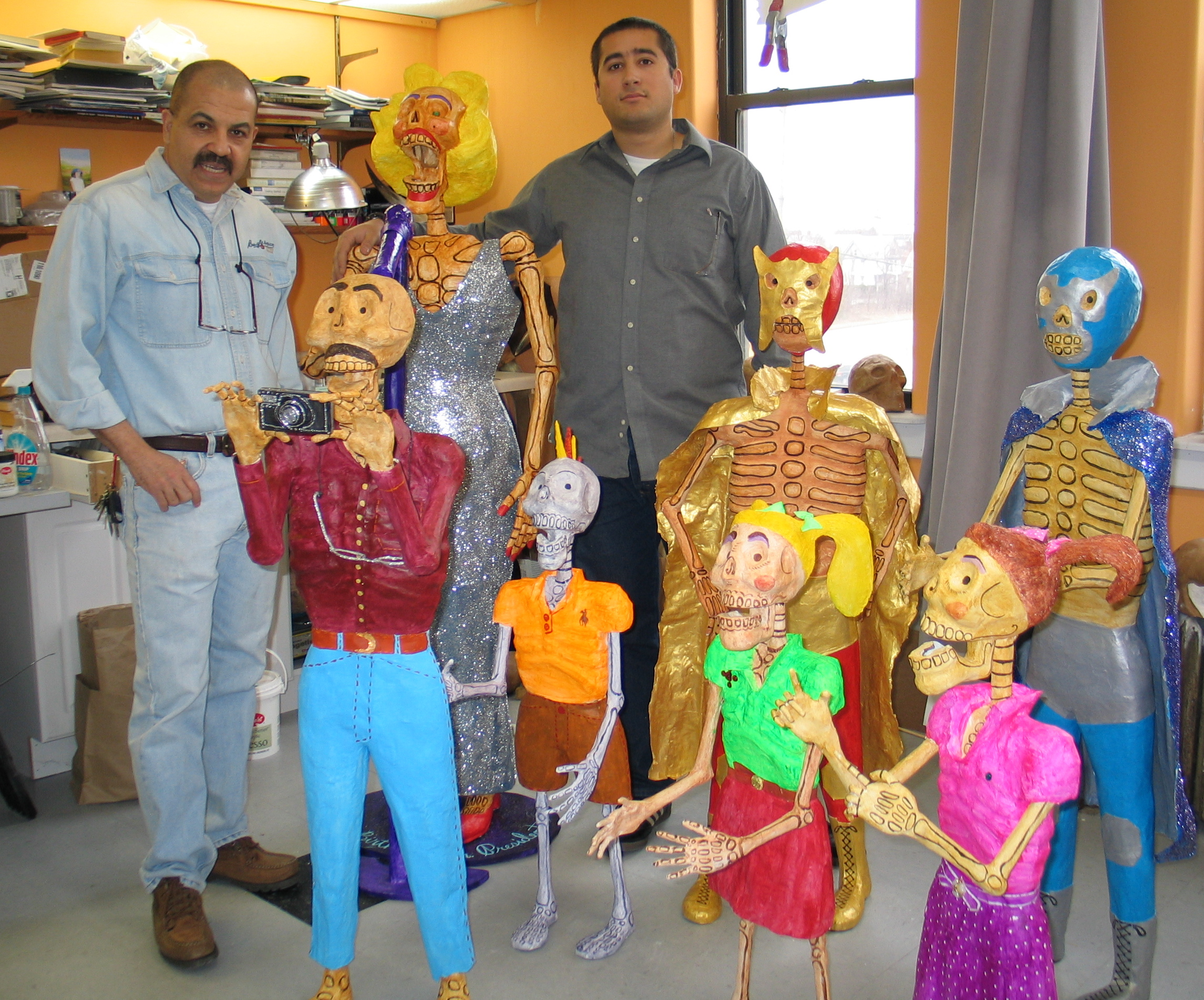 Jose Chavez and his apprentice Emiliano Lake-Herrera, both of Milwaukee, created paper mache figures used in Day of the Dead celebrations.