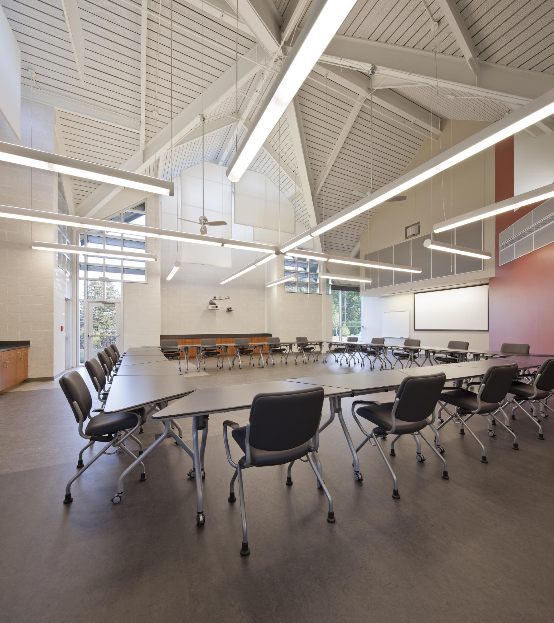 The Vernon S. Broyles Jr. Leadership Center's signature corner classroom is a large, contemplative multipurpose space with two gabled windows and flexible seating. c 2012 Jonathan Hillyer / Atlanta