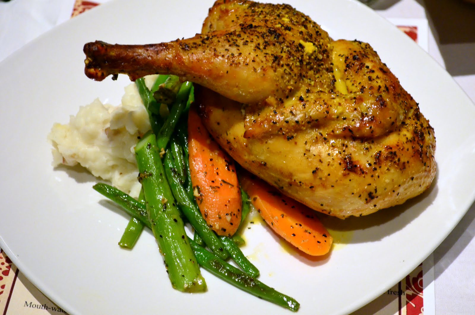 Half chicken with Yukon potatoes and seasonal vegetables