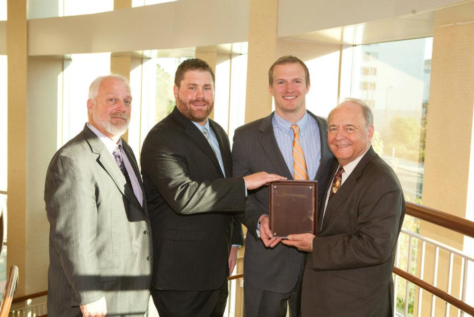 Nick Wagner and John Beitelspacher (two in center), winners of the 2011 Fowler Business Concept Challenge Graduate Division, pose with Dean Puto (far left) and Dr. David Deeds (far right). Not pictured: Jesse Sumstad. Photo courtesy of Tom Whisenand, University of St. Thomas.