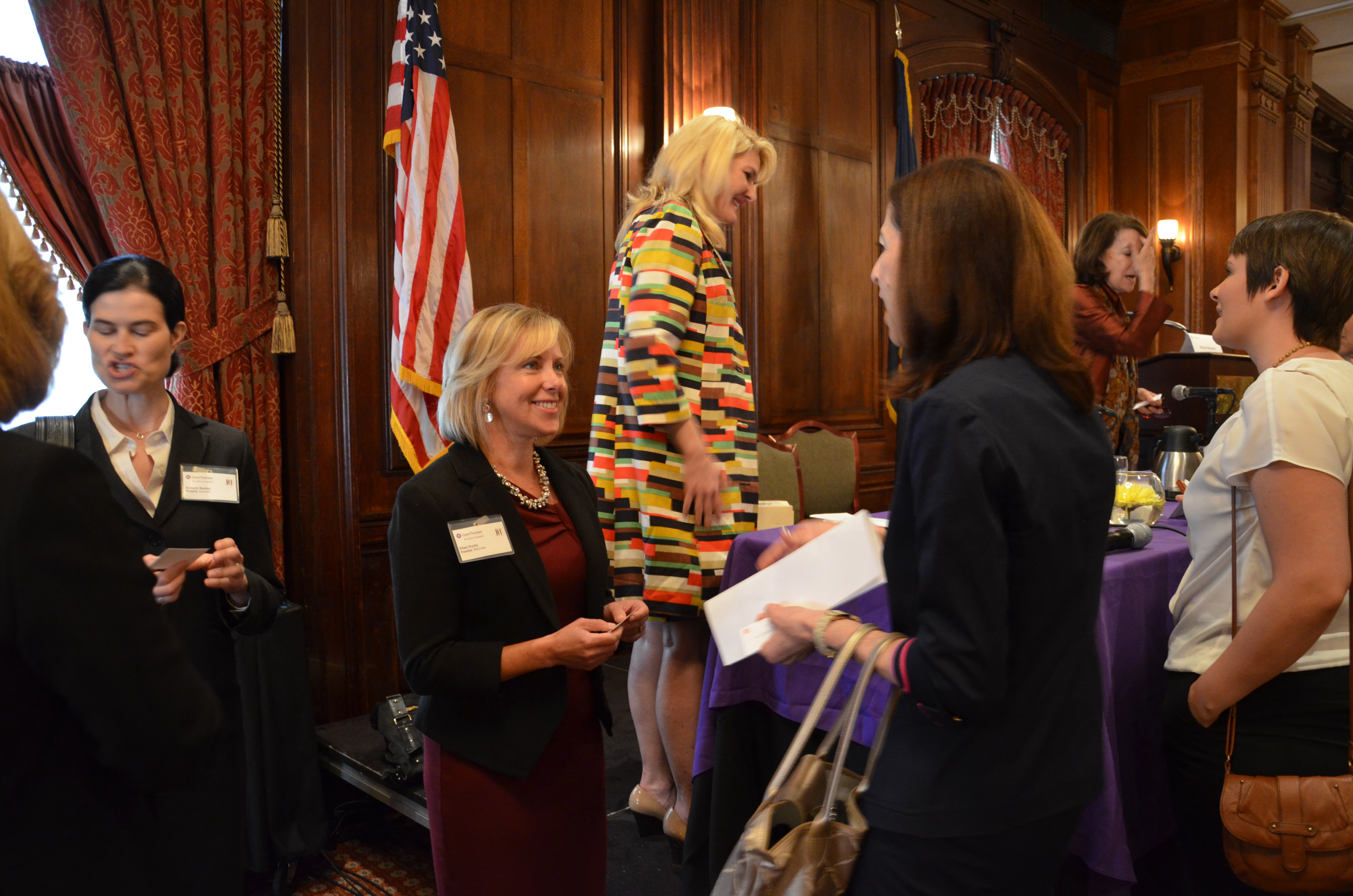 Ellen Purdy, CFO of Renmatix, meets with one of the participants after the Women@Grant Thornton event held last week at the Union League in Philadelphia.