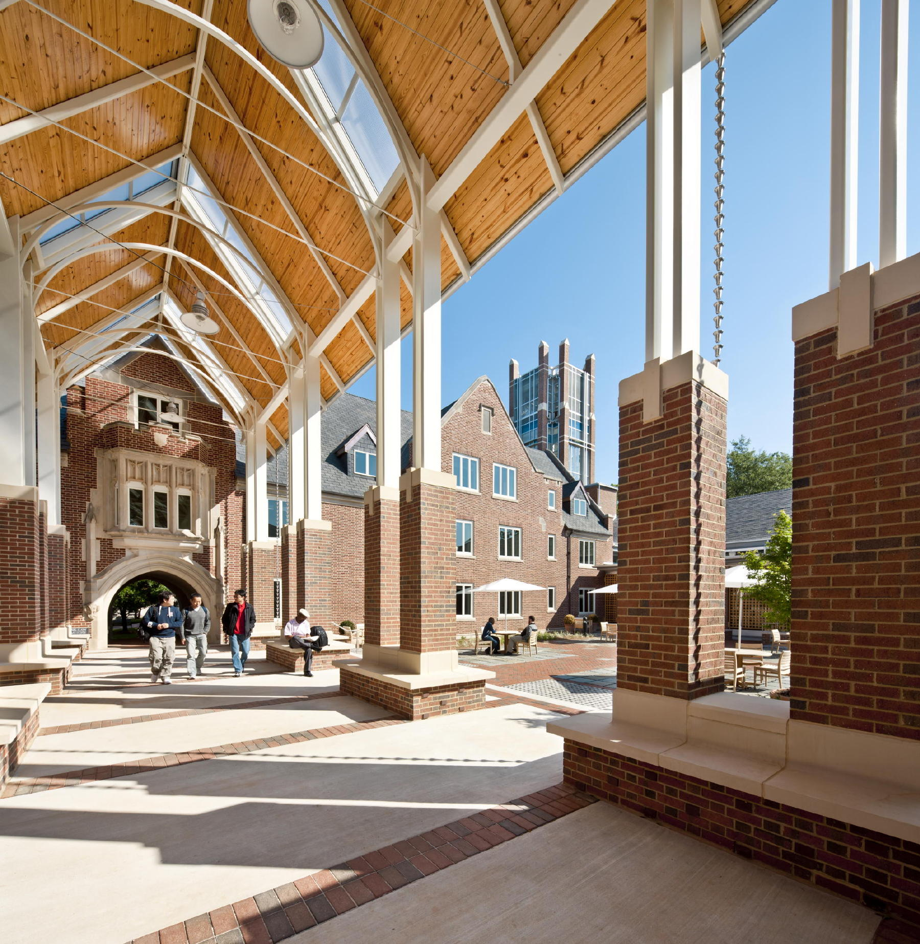 "Lord, Aeck & Sargent designed a new arcade, which is an extension of the repurposed dormitory's ""historic arch."" The arcade, combined with the repurposed dormitory and the new L-shaped classroom wings, created the courtyard, which was inspired by cloister typologies. c 2012 Jonathan Hillyer / Atlanta"