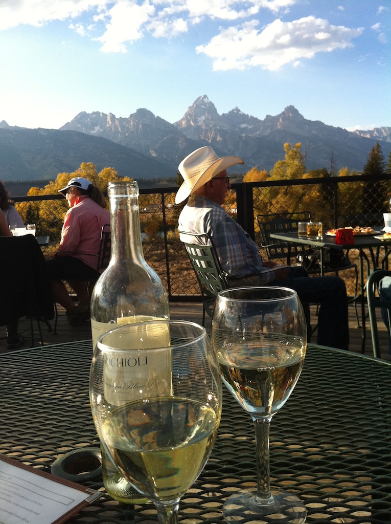 The view from Dornan's outdoor patio... a little sun and mountain, a little wine, and a little cowboy....