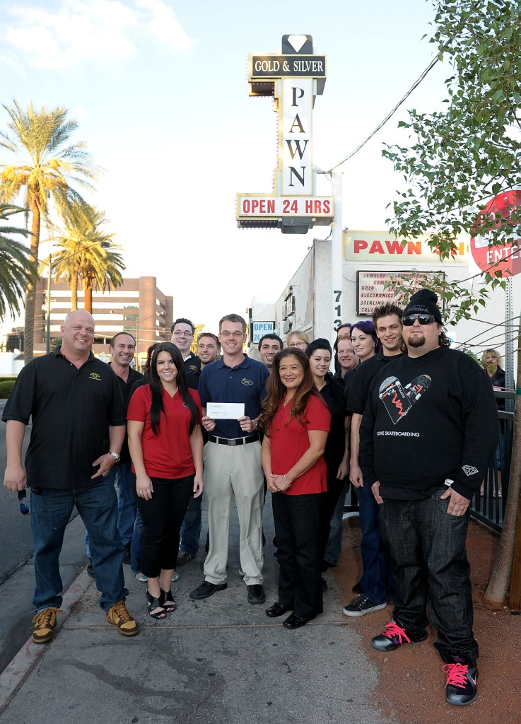 "Rick Harrison, Austin ""Chumlee"" Russel and fellow Gold & Silver Pawn Shop employees present representatives from the Justin Timberlake Shriners Hospitals for Children Open with a donation of $11,500 on behalf of Shriners Hospitals"