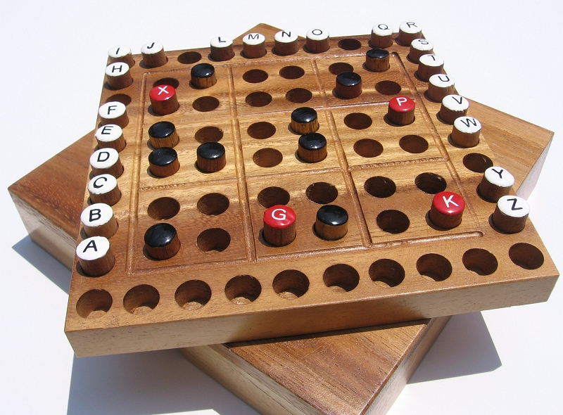 The Mentagy puzzle is available as a hardwood game board, book, or eBook.