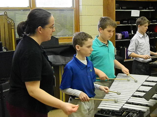 Hoover students benefit from the team teaching approach in instrumental music class.