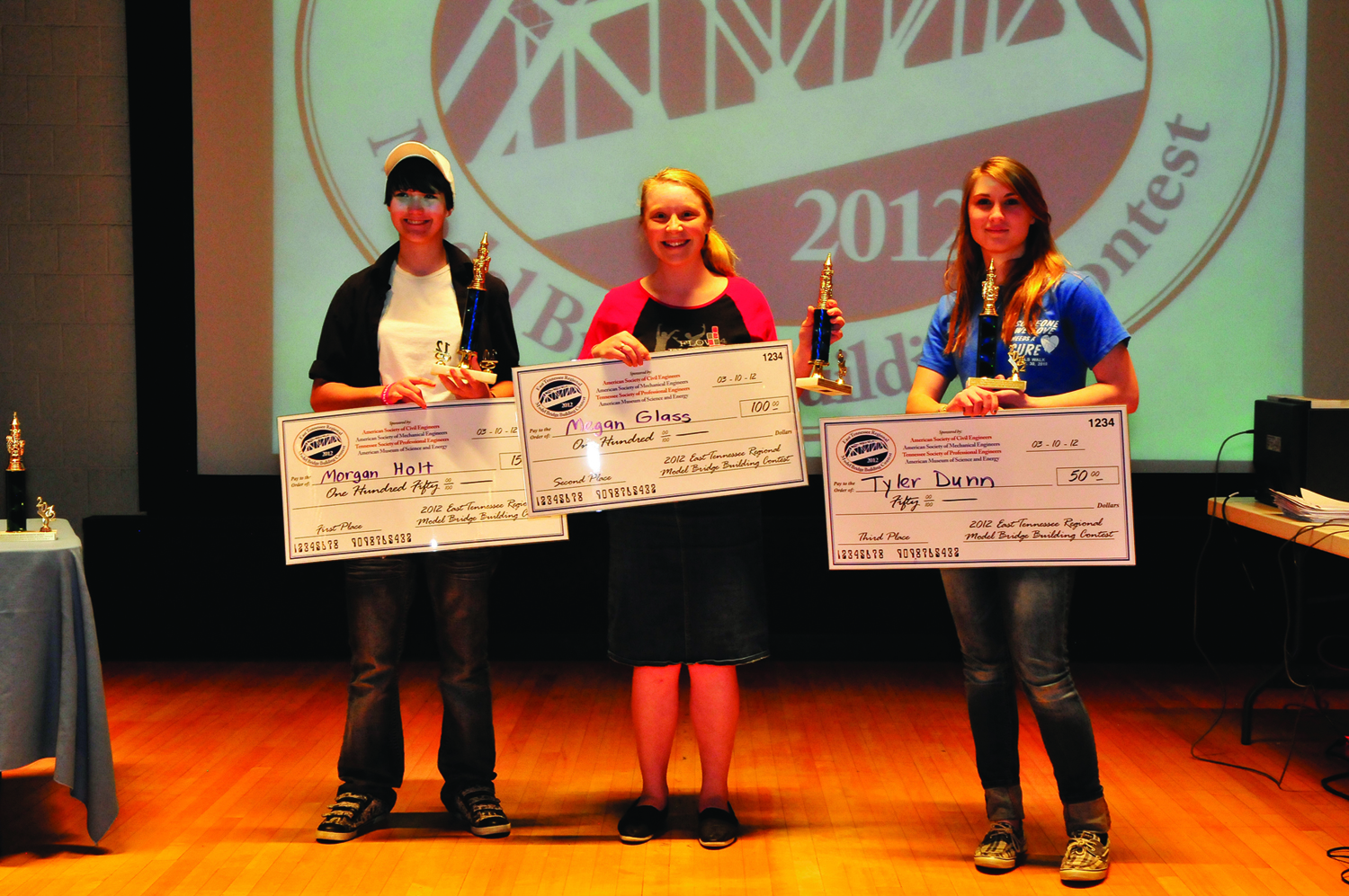 Blackman High School students captured the top three places in the Senior High Division (grades 9-12) of the East Tennessee Model Bridge Building Contest.  Receiving a trophy and cash award from left are Morgan Holt, first place and $150, Megan Glass, second place and $100 and Tyler Dunn, third and $50.  There were a total of 91 model bridges entered in the March 10 contest for students in grades 7 - 12 at AMSE