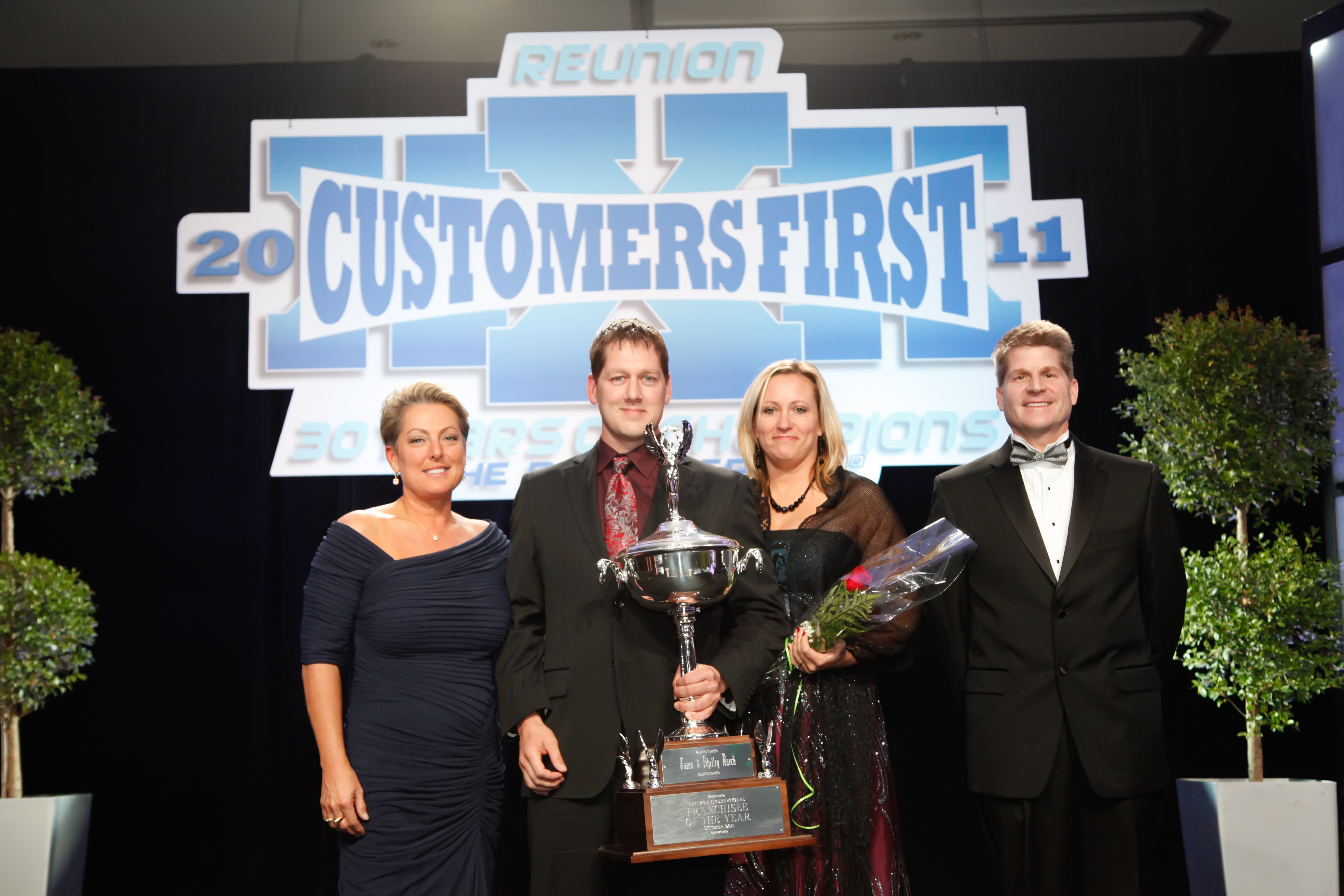 Left to Right: Dina Dwyer-Owens, CEO of The Dwyer Group; Jason & Shelley Barck, Franchisees of the Year Rainbow International of Des Moines; Rob White, President of Rainbow International