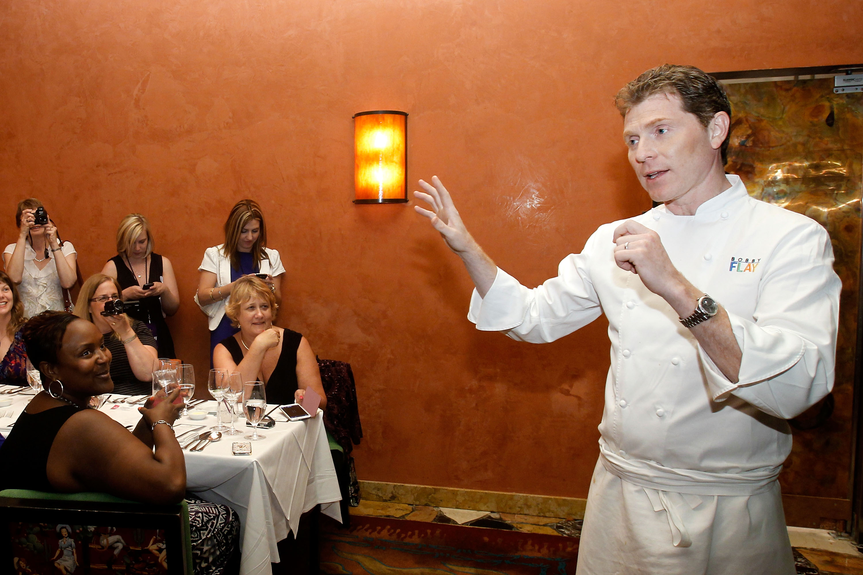 Bobby Flay entertaining guests at his Spices of Life Master Series Dinner for Vegas Uncork&#39;d. (photo credit: Isaac Brekken)