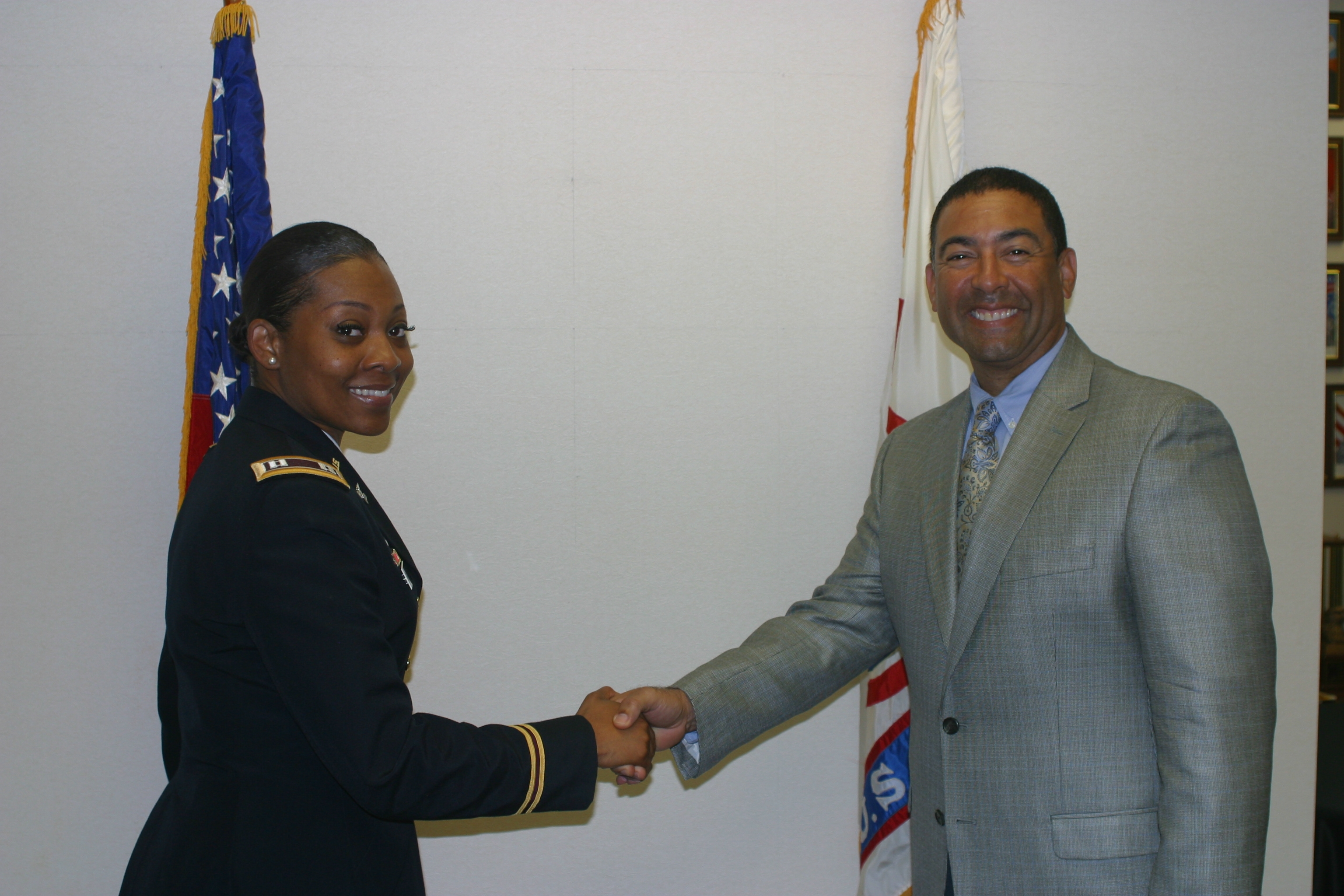 Congratulations after Dr. Jose Peralta has been sworn in as Captain in the U.S. Army Reserves Medical Support Unit.