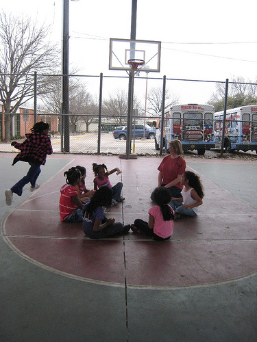 All that energy! Cara played duck-duck-goose with a group of girls at the BGC Plano branch on a warm, overcast afternoon in 2011.