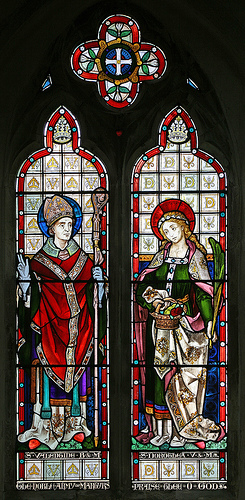 a stained glass window depicting saint valentine on the left and saint dorothea