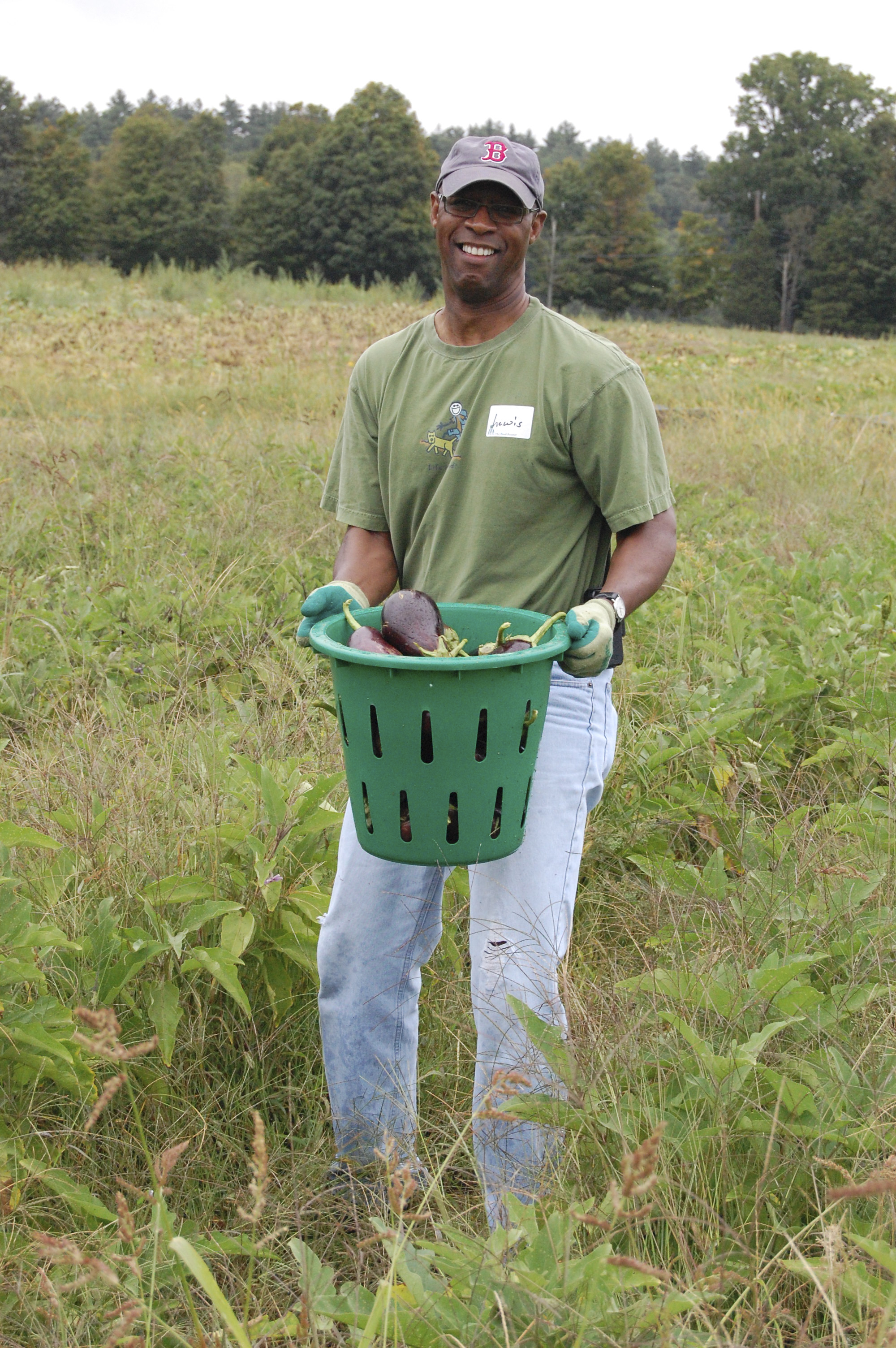 "Lewis Ware, Director of Housekeeping, shows off the ""fruits"" of his harvest for The Food Project"
