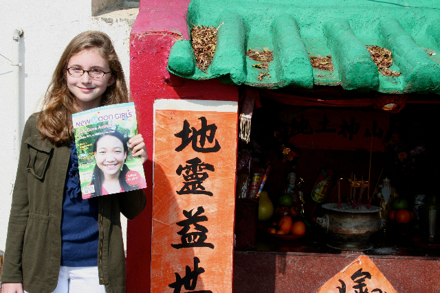 Lila with her New Moon Girls magazine in Hong Kong