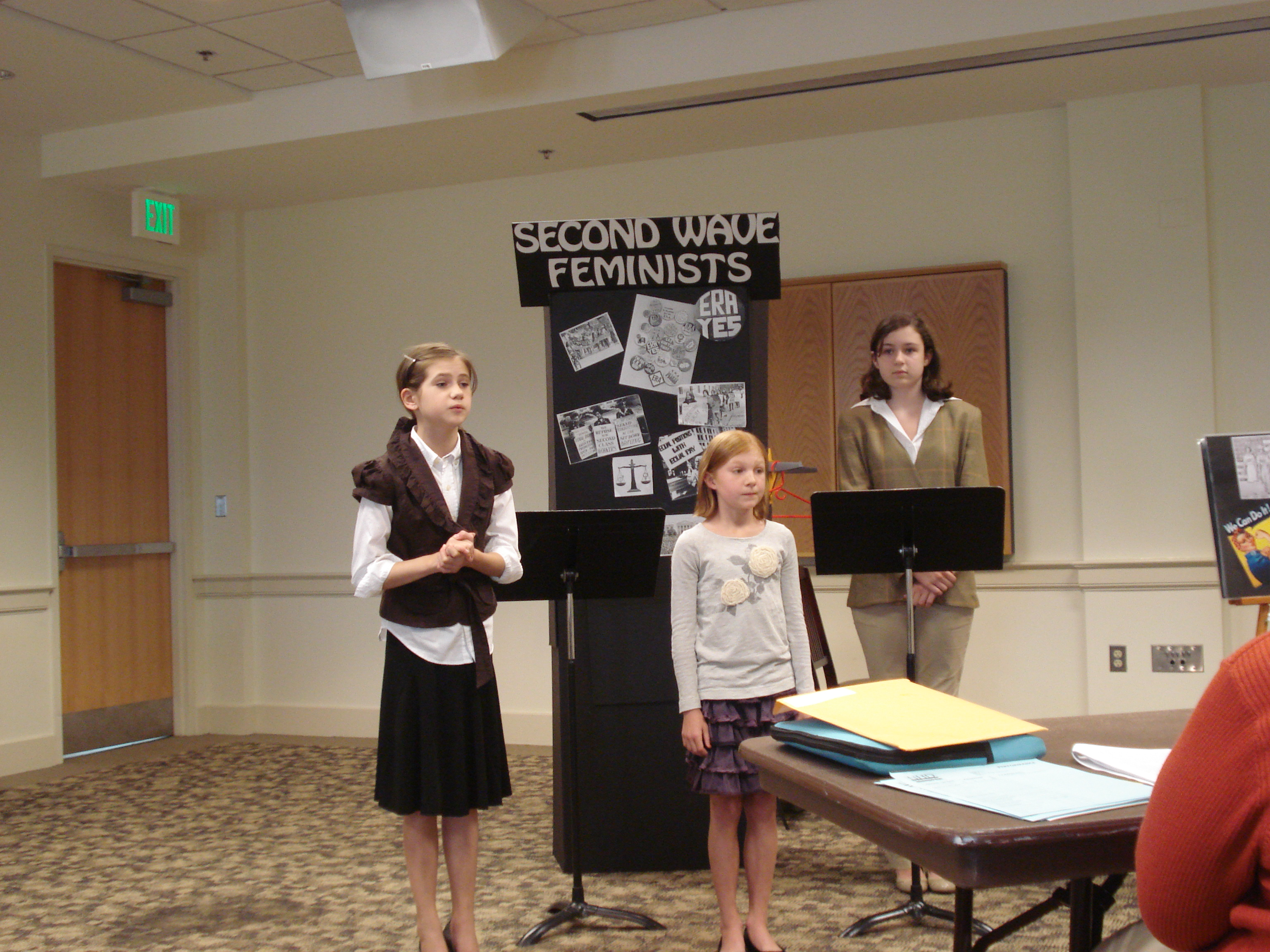 Students competing in 2011 at National History Day. Katherine Clark, Maggie Kubicek, and Margot Reid from Gilmour Academy perform their junior division project on women's rights at the 2011 National History Day competition