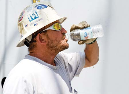 Drink 8 oz of water for every 15 minutes you work in extreme heat.