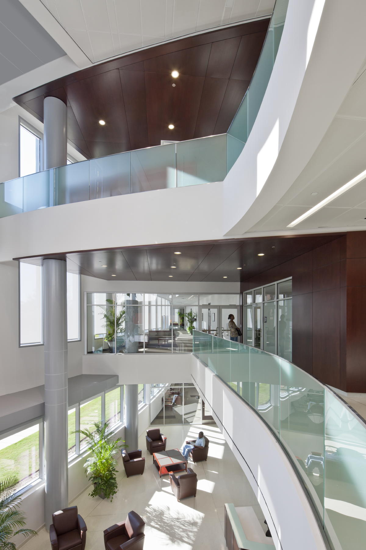 The CDMs Three Story Main Lobby Is Glass Enclosed And Features Rich Brown Wood Paneling