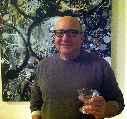 DC writer Thom Haller in front of Maryanne Pollack's painting Black Sand