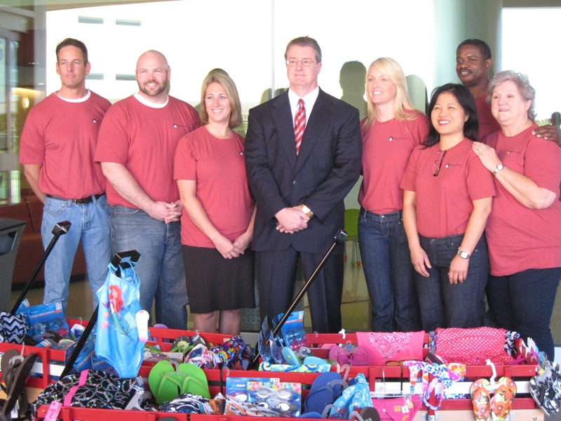 Ed Heffernan and Alliance Data employees donated nearly 200 swimsuits and swim accessories to Children's Injury Prevention Program in support of National Water Safety Month, as part of the celebration around Alliance Data's commitment to support Children's Medical Center through a four-year, $600,000 contribution, which brought the company's cumulative donations to more than $1 million. The swimsuits will be donated to underserved Dallas neighborhoods where Children's provides free swim lessons.