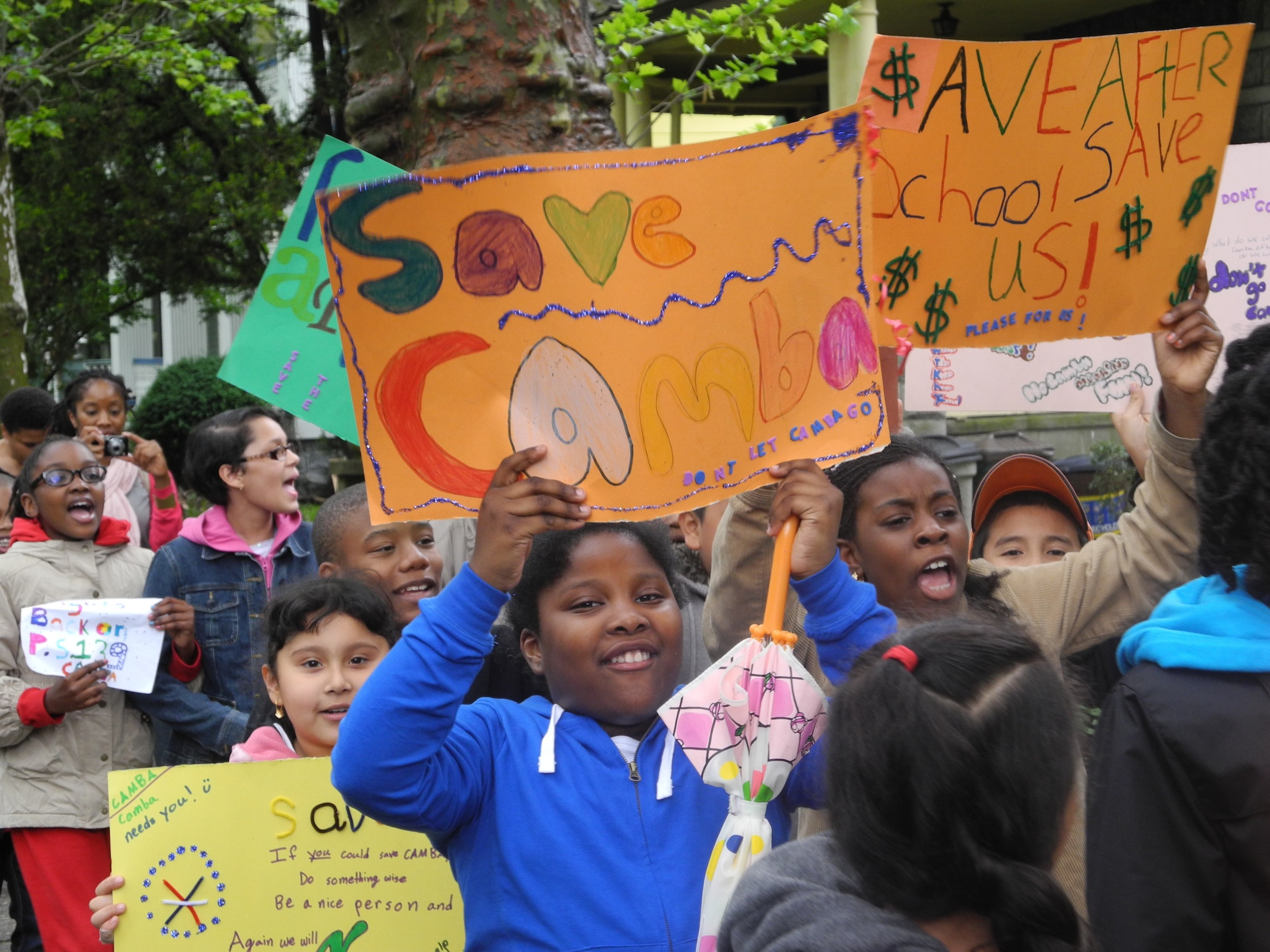 Brooklyn children voice their opposition to after-school budget cuts.