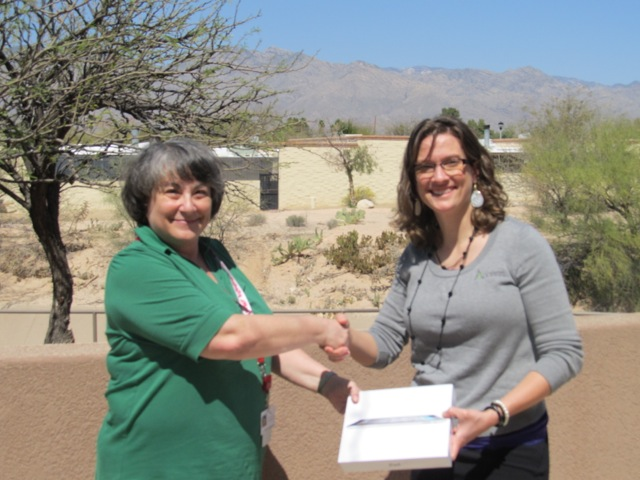 Access's Brandy Taylor presents iPad to Rita Cartwright