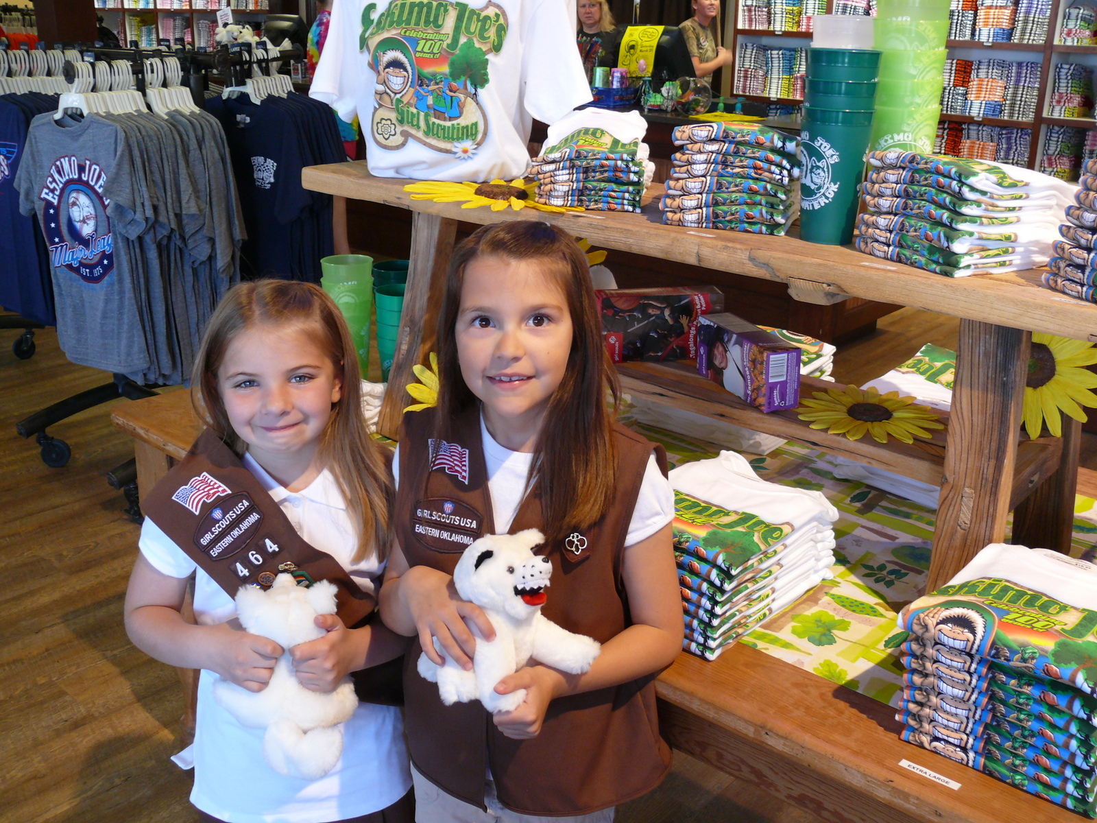 Girl Scouts Kirstyn and Lydia pose with Eskimo Joe&#39;s new 100th anniversary tee for Girl Scouts.